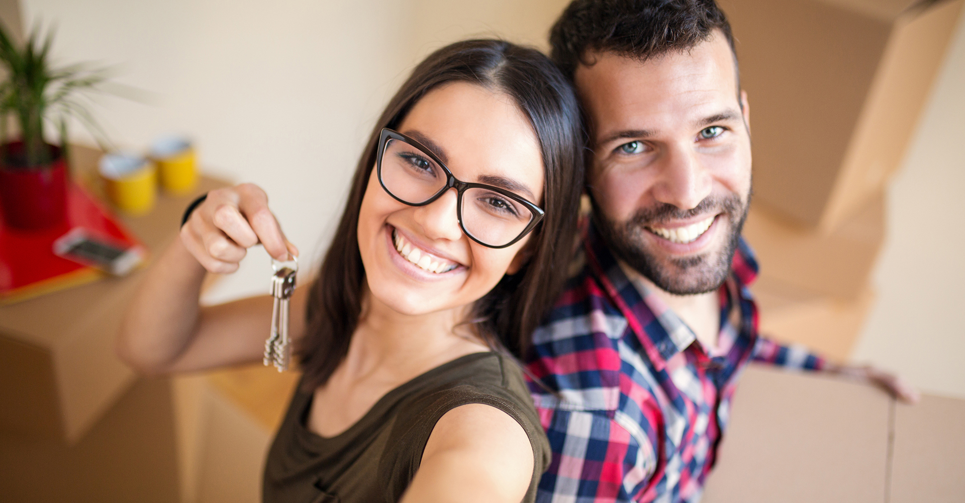 Couple with house keys moving into their new home